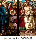 Small photo of Stained glass window depicting Easter resurrection story of Doubting Thomas