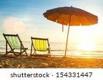 beach loungers on deserted... | Shutterstock . vector #154331447