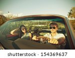 couple taking a road trip in... | Shutterstock . vector #154369637