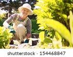 happy elder woman with... | Shutterstock . vector #154468847