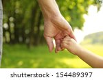 a parent holds the hand of a... | Shutterstock . vector #154489397
