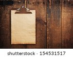 old clipboard on grungy wooden... | Shutterstock . vector #154531517