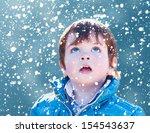 Child Looking Snow Falling Wit...
