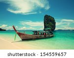 long tourist boat to cross to... | Shutterstock . vector #154559657