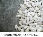 Pumpkin Seeds On Gray Background