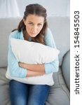 Relaxed Woman Sitting On Sofa...