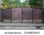 An Old Iron Gate In Front Of A...
