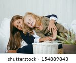two cute sisters at home playing | Shutterstock . vector #154889843