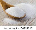 sugar on wooden table.... | Shutterstock . vector #154934213