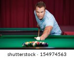 Man Playing Pool. Confident...
