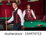 playing pool. two cheerful...   Shutterstock . vector #154974713