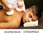 young man having back massage... | Shutterstock . vector #155069063