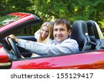 happy couple in red cabriolet... | Shutterstock . vector #155129417