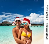couple in santa's hat on a... | Shutterstock . vector #155256617
