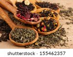 Stock photo assortment of dry tea in spoons on wooden background 155462357