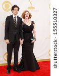 Постер, плакат: Christina Hendricks and husband