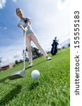 woman playing golf at the... | Shutterstock . vector #155555183