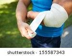 close up of male bandaging his... | Shutterstock . vector #155587343