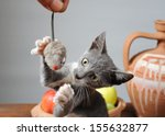 Stock photo cat playing with a plush mouse 155632877