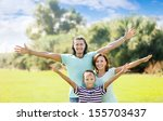 happy couple with teenage boy... | Shutterstock . vector #155703437
