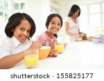 mother making school packed... | Shutterstock . vector #155825177