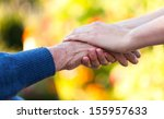 Young Female Hand Holding An...