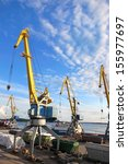 port cranes against the blue... | Shutterstock . vector #155977697