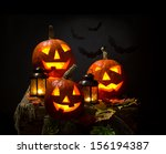 Halloween Pumpkins And Bat Wit...