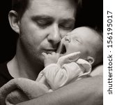 Small photo of Father and his newborn baby. MANY OTHER PHOTOS FROM THIS SERIES IN MY PORTFOLIO.
