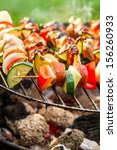 hot skewers with vegetables on...
