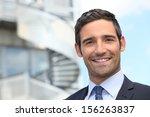smiling business man standing... | Shutterstock . vector #156263837