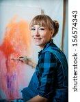 Beautiful Blonde Woman Painter...