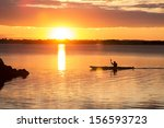 man rowing at sunset in denmark | Shutterstock . vector #156593723