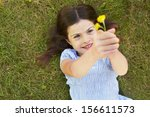 young girl lying on grass... | Shutterstock . vector #156611573