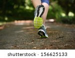 woman jogging away from camera... | Shutterstock . vector #156625133