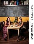 two beautiful women in a coffee ...   Shutterstock . vector #156638543