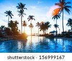 beautiful sunset at a beach... | Shutterstock . vector #156999167