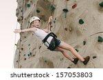 a teen girl climbing on a rock... | Shutterstock . vector #157053803