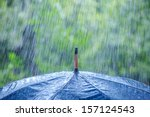 umbrella and rain drops closeup | Shutterstock . vector #157124543