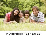 family outdoors smiling | Shutterstock . vector #15713611