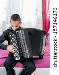 Small photo of close up portrait of young accordionist