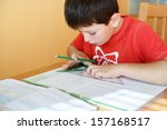 boy doing school homework from... | Shutterstock . vector #157168517