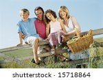 family outdoors by fence with... | Shutterstock . vector #15718864
