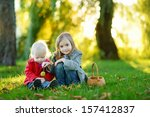 two little sisters playing... | Shutterstock . vector #157412837