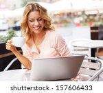 smiling young woman with laptop ... | Shutterstock . vector #157606433