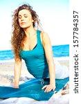 beautiful girl doing yoga on... | Shutterstock . vector #157784357