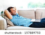 Man Relaxing With Laptop On...