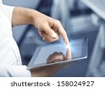 hand holding and pushing tablet ... | Shutterstock . vector #158024927