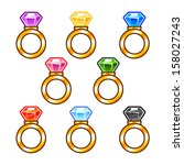 gold rings with colorful...