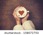 Woman Holding Hot Cup Of Coffe...